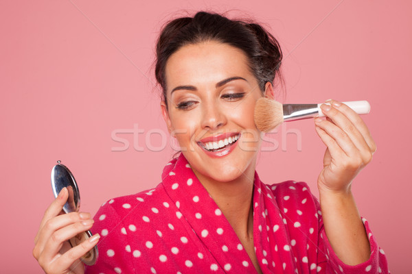 Laughing woman applying blusher Stock photo © stryjek