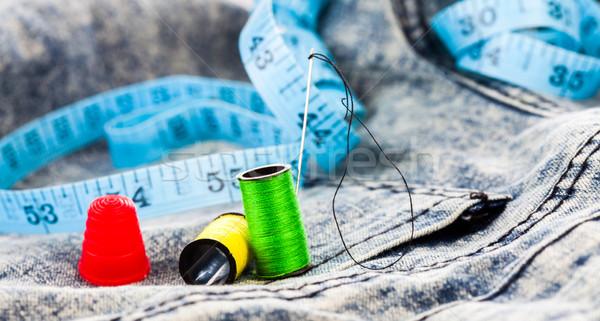 Sewing accessories on denim jeans Stock photo © stryjek