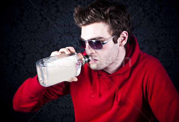 young man drinking and feeling despair Stock photo © stryjek