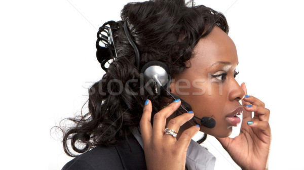 Sorridere imprenditrice parlando servizio di assistenza telefono auricolare Foto d'archivio © stryjek