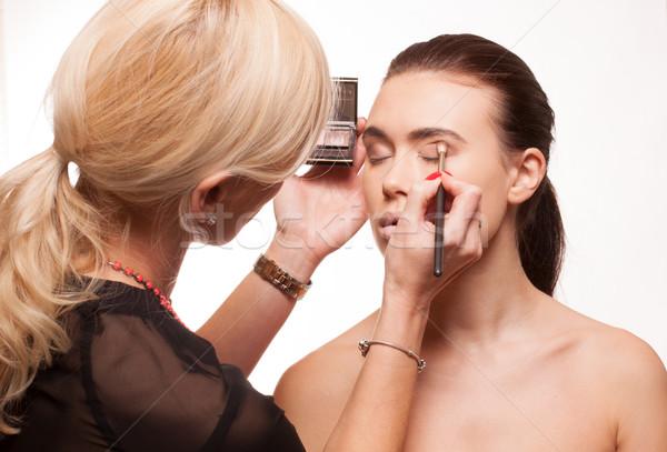 Beautician applying eye makeup Stock photo © stryjek