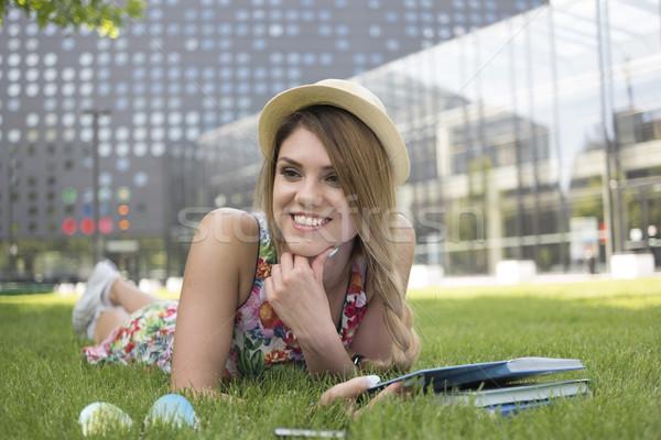Happy Teen Girl Lying on her Stomach on the Grass Stock photo © stryjek