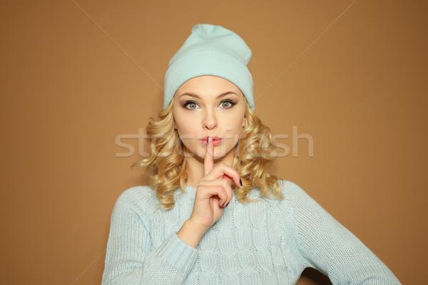 Gorgeous young woman making a shushing gesture Stock photo © stryjek