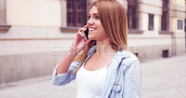 Young Woman with Phone Walking at the Street Stock photo © stryjek