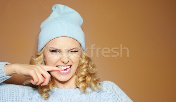 Gorgeous young woman with blond ringlets in a green knitted winter outfit Stock photo © stryjek