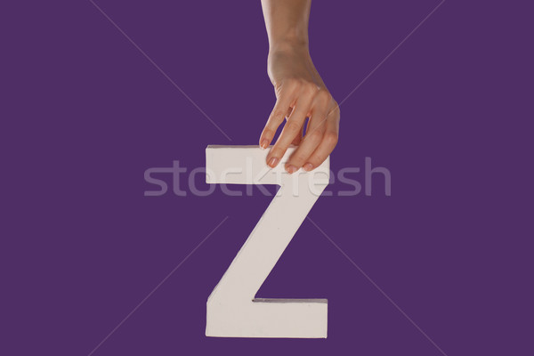 Female hand holding up the letter Z from top Stock photo © stryjek