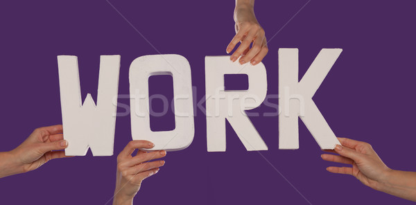Lettering WORK held in female hands Stock photo © stryjek