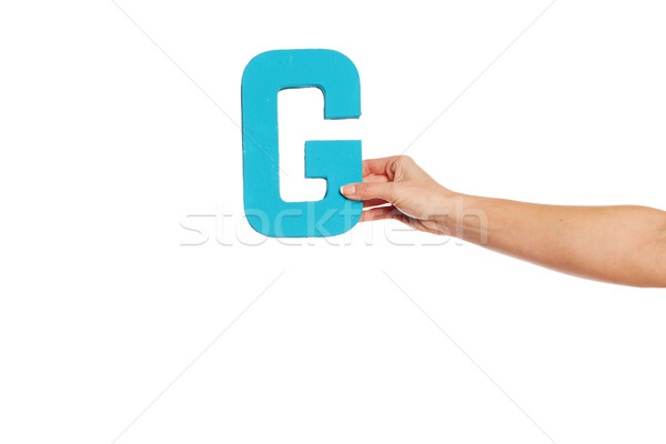 hand holding up the letter G from the right Stock photo © stryjek