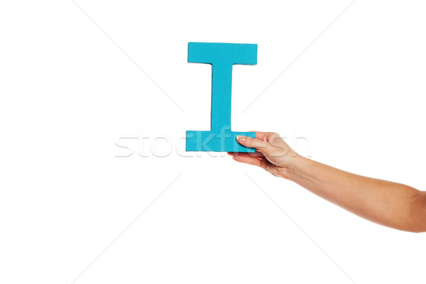 hand holding up the letter I from the right Stock photo © stryjek