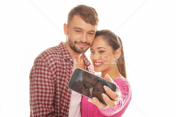 Young couple taking a self-portrait Stock photo © stryjek