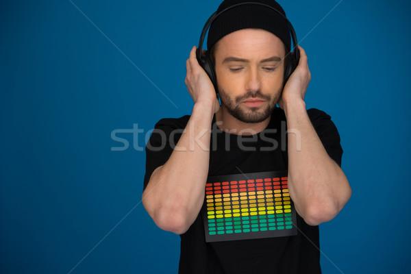 Foto stock: Bonito · masculino · fones · de · ouvido · azul · feliz · retrato