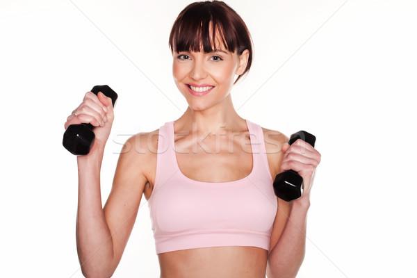 Happy Active Woman Using Dumbbells Stock photo © stryjek