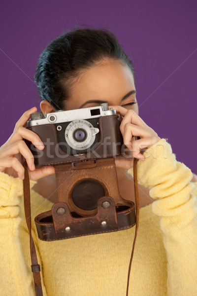 Woman using a vintage camera Stock photo © stryjek