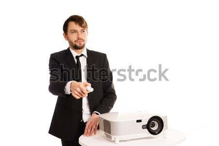 Businessman using a projector for a presentation Stock photo © stryjek