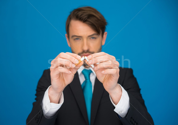 business holding a broken cigarette Stock photo © stryjek