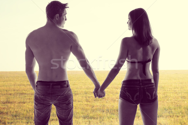 Romantic young couple holding hands Stock photo © stryjek
