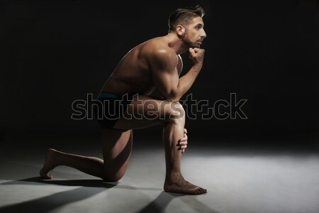 Topless Muscular Man Sitting in a Yoga Position Stock photo © stryjek