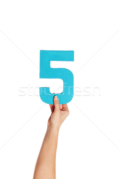 Stock photo: hand holding up the number five from the bottom