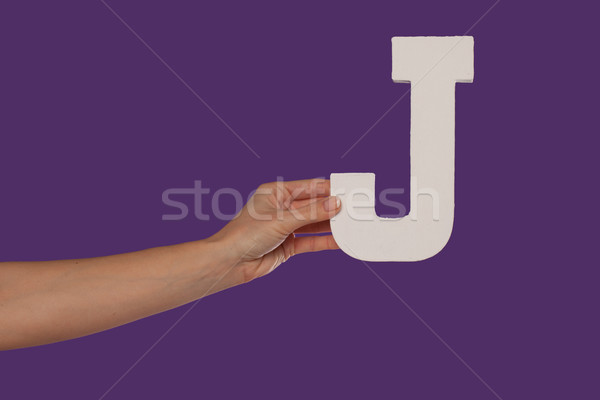 Female hand holding up the letter J from the left Stock photo © stryjek