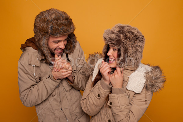 Happy couple in warm winter clothing Stock photo © stryjek