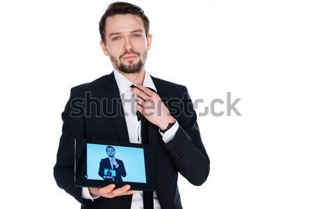 Businessman showing a self-portrait on a tablet Stock photo © stryjek