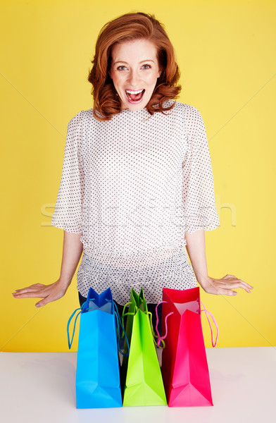 Excited Woman With Shopping Bags Stock photo © stryjek