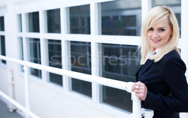 Businesswoman and corporate building Stock photo © stryjek