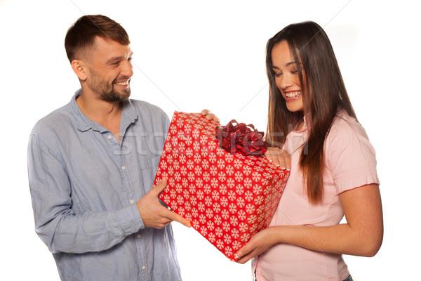 Fiatalember felajánlás ajándék barátnő izolált fehér Stock fotó © stryjek