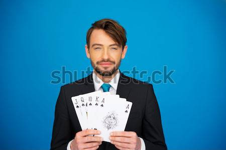 young business man showing playing cards Stock photo © stryjek