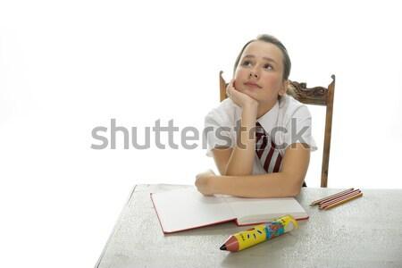 Young schoolgirl sitting doing her homework Stock photo © stryjek
