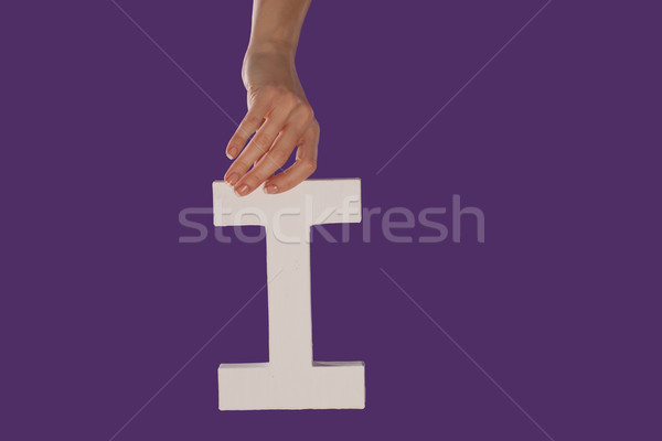 Female hand holding up the letter I from top Stock photo © stryjek