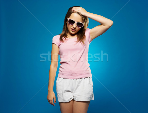 Trendy young girl with a headache Stock photo © stryjek