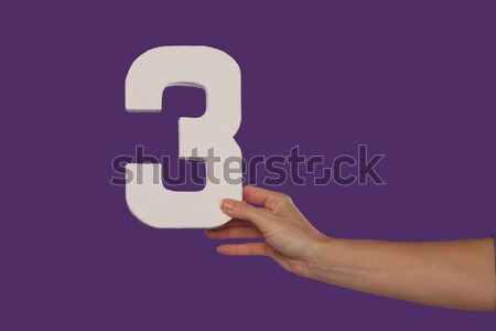 Female hand holding up the number 3 from the right Stock photo © stryjek