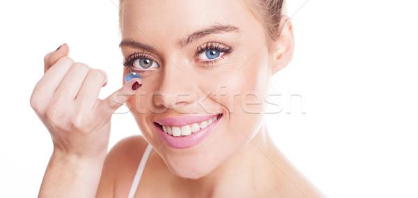 Bela mulher lente de contato grande sorrir olho dedo Foto stock © stryjek