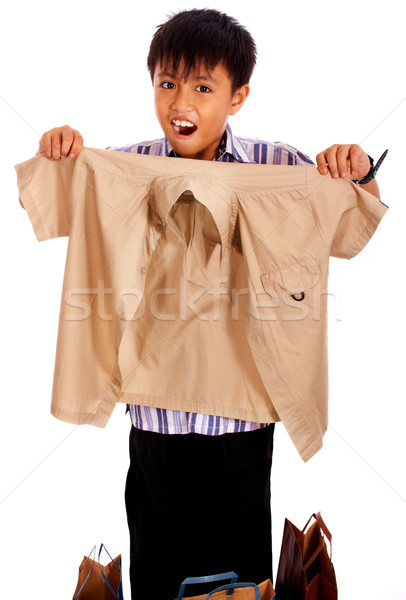 Jongen uit naar shirt gekocht winkel Stockfoto © stuartmiles