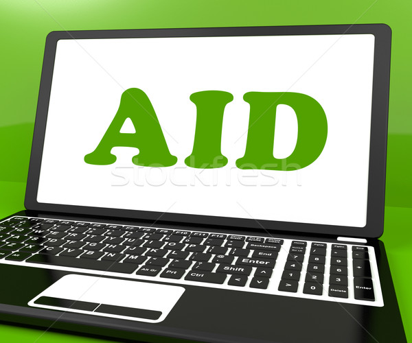Aid On Laptop Shows Assisting Aiding Help Or Relief Stock photo © stuartmiles
