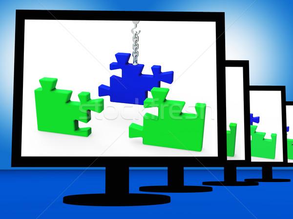 Unfinished Puzzle On Monitors Showing Strategy Stock photo © stuartmiles