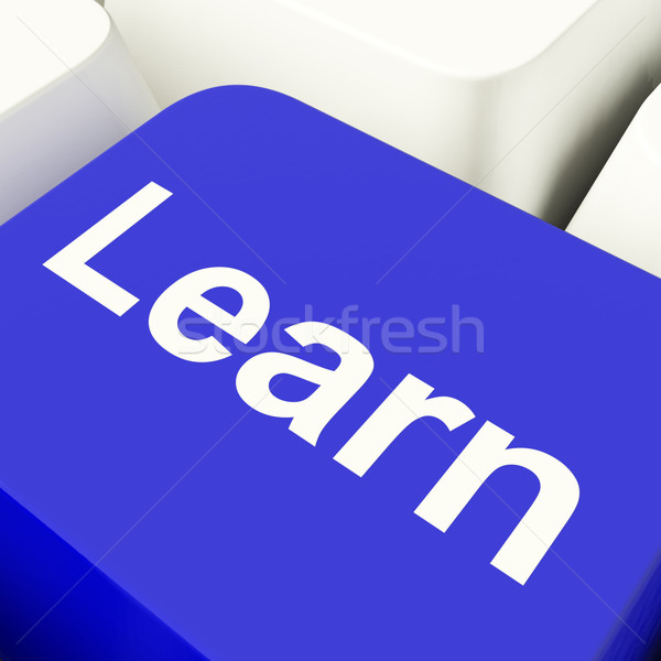 Learn Computer Key In Blue Showing Online Learning And Education Stock photo © stuartmiles