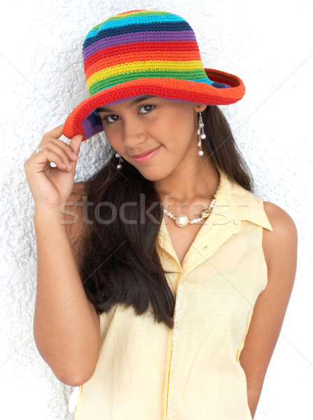 Happy Cute Girl In A Bright Colored Hat Stock photo © stuartmiles