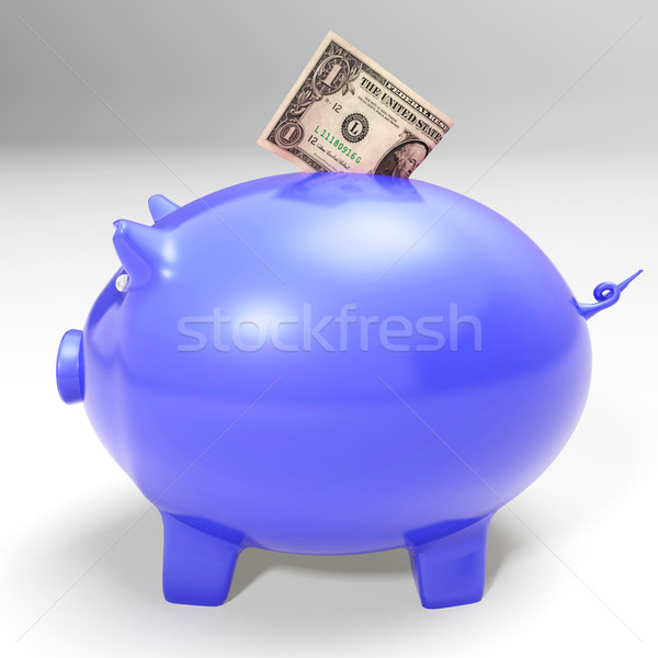 Dollar Entering Piggybank Showing American Savings Stock photo © stuartmiles