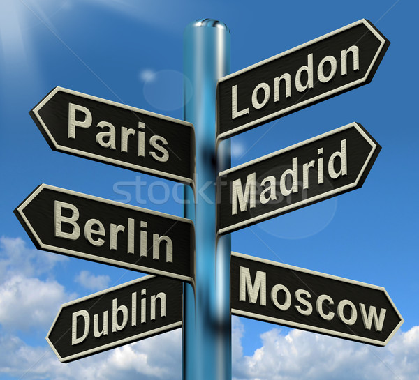 London Paris Madrid Berlin Signpost Showing Europe Travel Touris Stock photo © stuartmiles