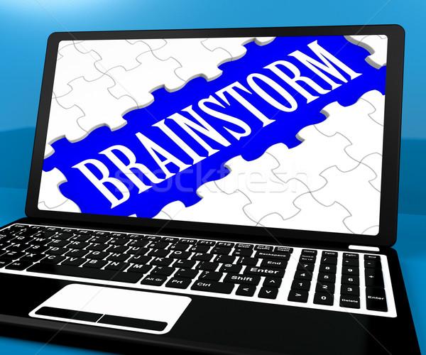 Burza mózgów puzzle notebooka pomysły ebook Zdjęcia stock © stuartmiles