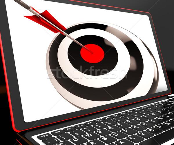 Dartboard On Laptop Shows Effectiveness Stock photo © stuartmiles