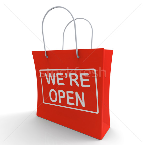 Stock photo: We're Open Shopping Bag Shows New Store Launch