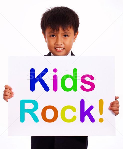 Stok fotoğraf: çocuklar · kaya · imzalamak · simge · çocukluk · çocuklar