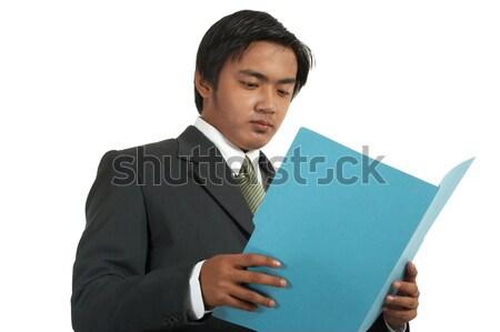 Businessman Reviewing A Folder Stock photo © stuartmiles