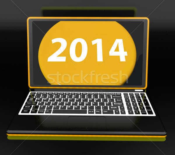 Two Thousand And Fourteen On Laptop Shows New Year Resolution 20 Stock photo © stuartmiles