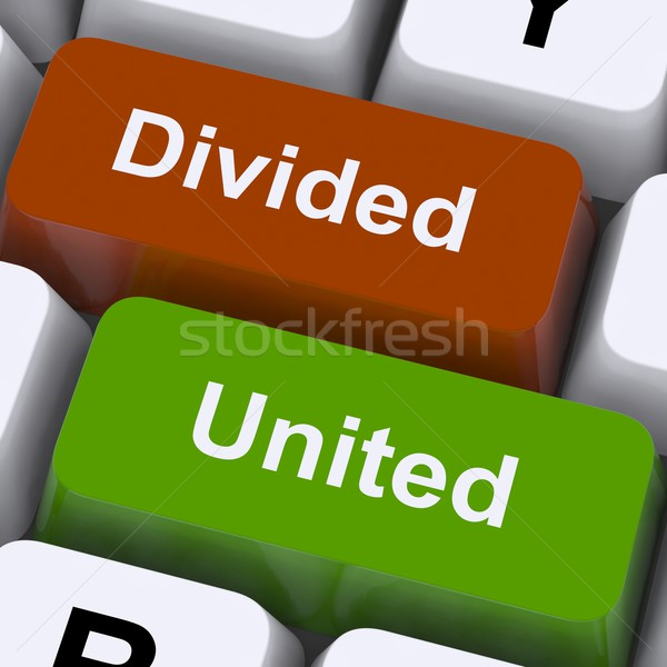 Divided And United Keys Show Partnership Or Teamwork Stock photo © stuartmiles