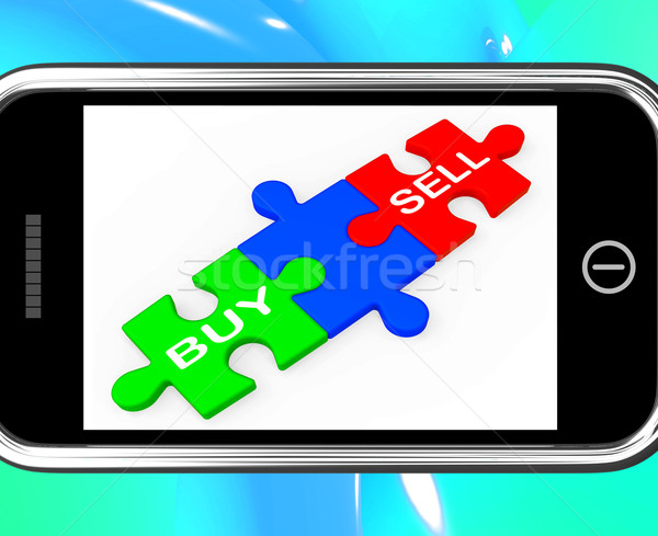 Buy And Sell Puzzles On Smartphone Shows Commerce Stock photo © stuartmiles