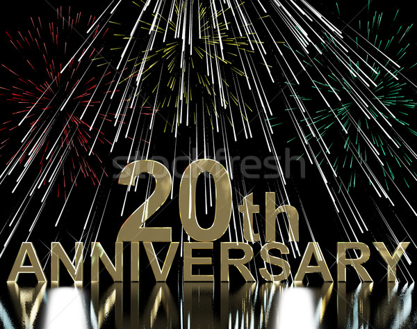 Gold 20th Anniversary With Fireworks For Twentieth Celebration O Stock photo © stuartmiles